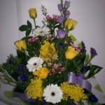 Purple and yellow boxed bouquet
